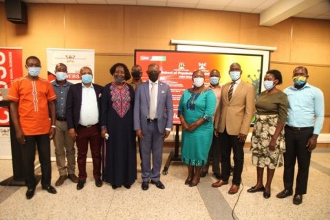 The Vice Chancellor, Prof. Barnabas Nawangwe (C) with the Principal CHUSS, Dr Josephine Ahikire (5th L) and the researchers at the end of the dissemination events